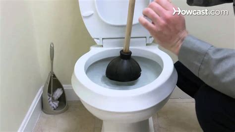 fix clogged bathroom how to fix a clogged toilet plumbing repairs youtube