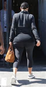 kim kardashian in workout gear and kanye west s trainers