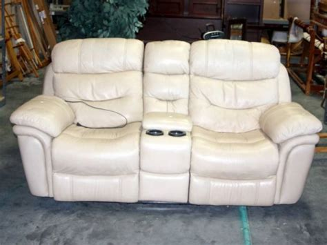 single recliner with cup holder cream electric leather dual recliner with center storage