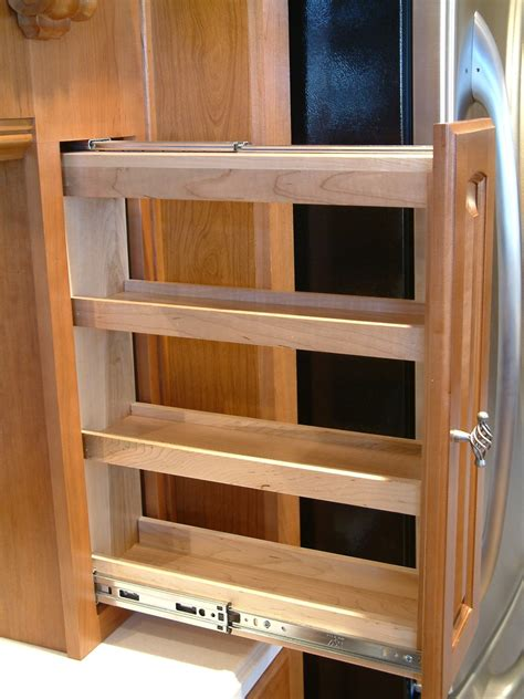 perhaps a pull out spice rack kitchen