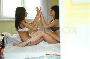 hot girls in bed together teenage girls lying on the bed together stock photo