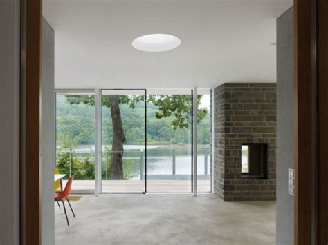 modern german house clad in glass offers unabated lake views modern german house clad in glass offers unabated lake