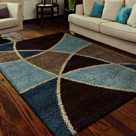 blue and brown rugs rugs beige sofa with cool pattern brown and blue area rugs and wood flooring for modern living room