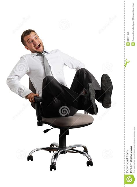 white rolling desk chair merry businessman rolling on the office chair stock photo