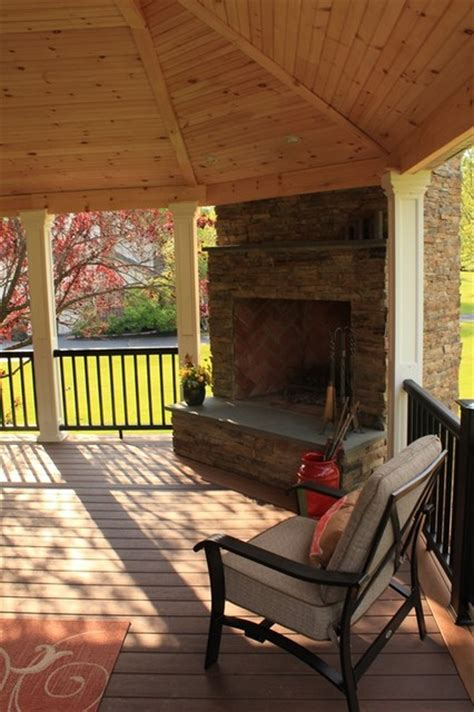 covered deck with built in fireplace