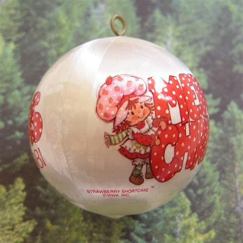 merry christmas  strawberry shortcake tree ornament brown eyed rose