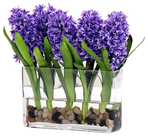 Blue Artificial Flowers In Vase by Blue Hyacinth In Glass Vase With River Rocks