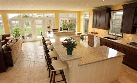 the kitchen island serves many purposes design indulgences please review my warm modern kitchen
