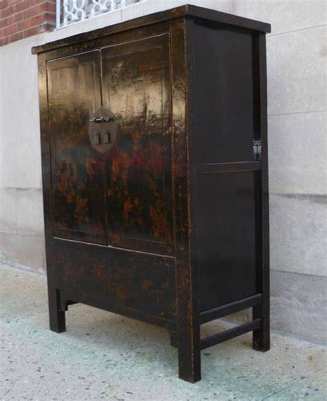 red or black lacquer gilt black lacquer cabinet with gold gilt motif for sale at 1stdibs