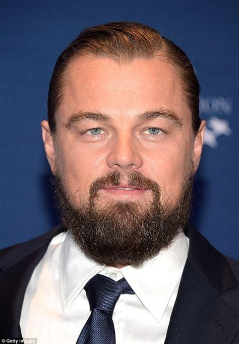 leonardo dicaprio shows bushy beard at clinton awards