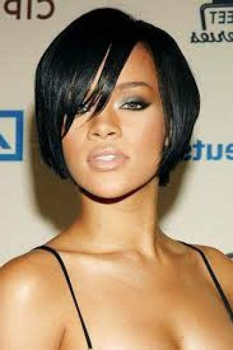 pic of black women side swept bangs and bun hairstyle 13 rihanna short hairstyles pixie to bob