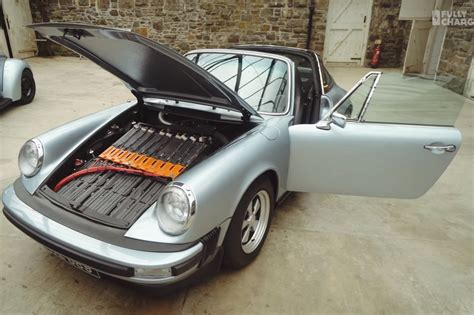 electric porsche conversion a tesla battery pack mutes this classic porsche 911 s flat