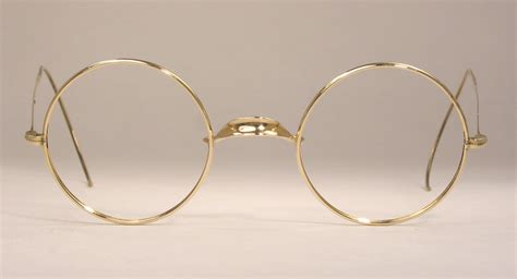 vintage gold frame eyeglasses global business forum iitbaa