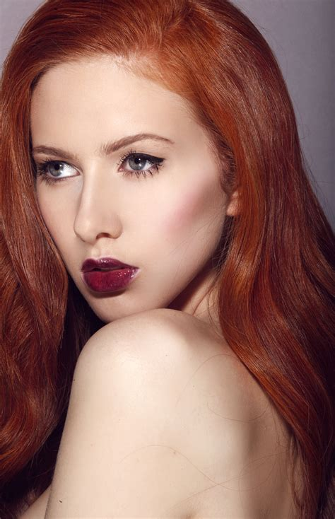 actress with bright red hair redhead into the red