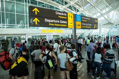 Aniston Causes Chaos At Airport by Bali Airport Closures Cause Chaos Again Mix 102 3