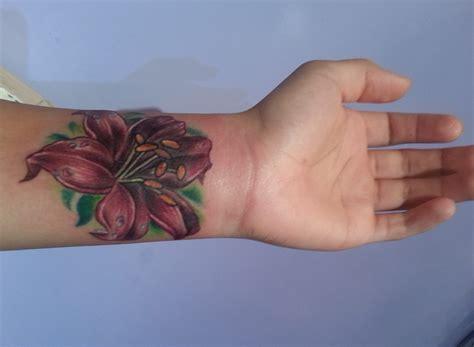 tattoo on wrist meaning flower wrist tattoos designs ideas and meaning tattoos