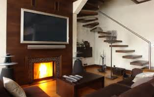 mounting your tv above the fireplace the debate heats up