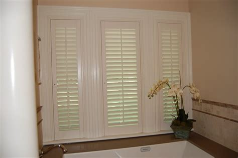 plantation shutters for bathroom window plantation shutters traditional bathroom boston by