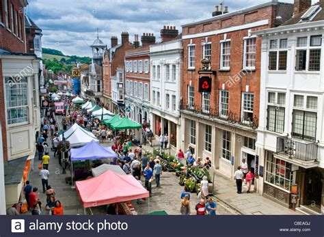 high street british companies united kingdom uk guildford historic high street and shoppers on a busy