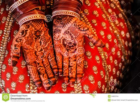 beautiful henna and bangles on bride s hands stock images