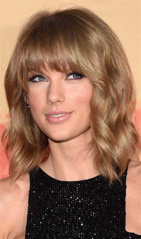 feathered bangs on long hair 10 stunning feathered bob hairstyles to inspire you 1