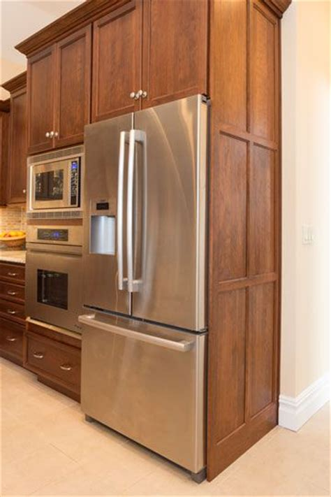 the refrigerator is housed in a cabinet with decorative