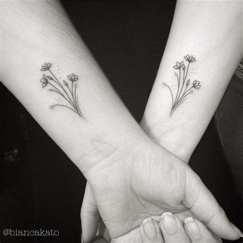flower sister tattoos 77 deliciously delicate wrist tattoos tattoomagz