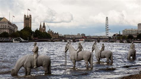 river thames underwater underwater horsemen emerge from the thames in protest