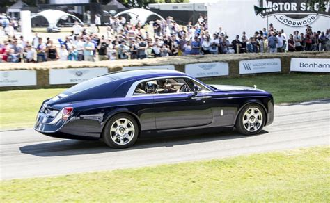 roll royce side rolls royce dawn black badge debuts at goodwood festival