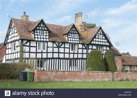 esl buying a house elizabethan timbered house in a traditional english village in stock photo royalty