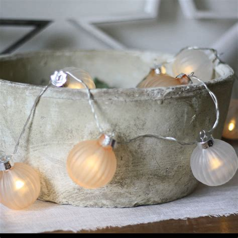 white and bronze bauble light string by the wedding of my