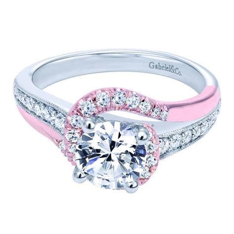 a 14k white pink gold bypass engagement ring