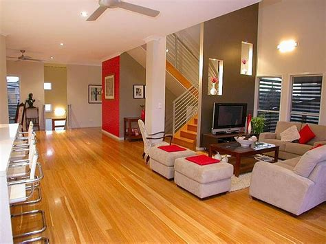 open stairs in living room open plan living room using brown colours with hardwood staircase living area photo 353677