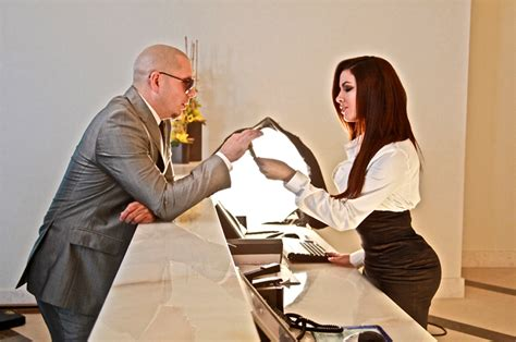 hotel room service pitbull exclusive pictures and from pitbull s new quot hotel room service quot featuring feisty