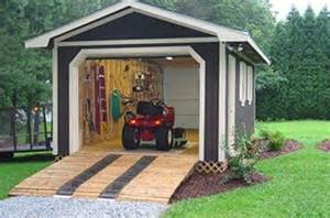 Lawn Mower Sheds by Storage Buildings Garage And Lawn Mower On