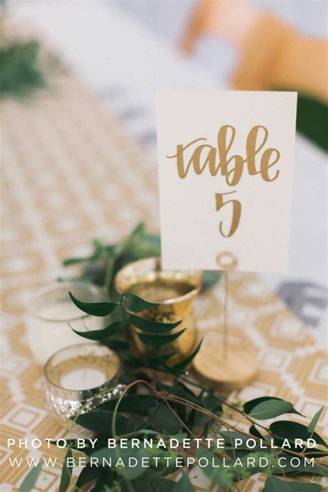gold calligraphy table numbers 18 inspiring wedding table number ideas to page 2