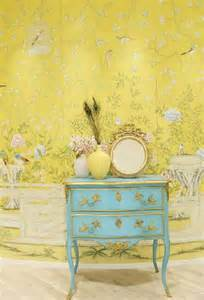 Sunny yellow strewn with vines birds and gorgeous flowers creates a