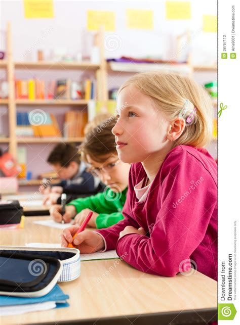 Elementary Homework School by Education Pupils At School Doing Homework Stock Photos