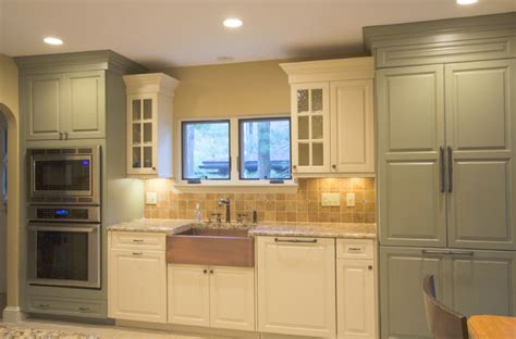 hint of green two tone kitchen with copper accents copper farm sink white painted wood two tone kitchens traditional kitchen boston by