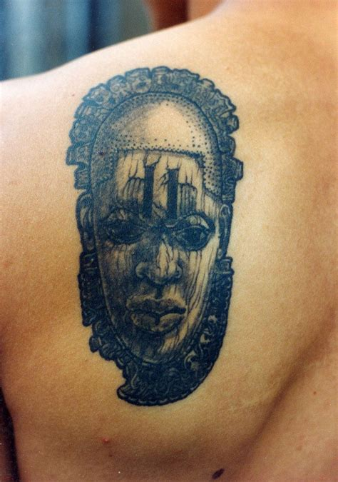african mask tattoo designs on back shoulder idea