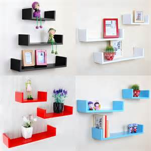 set of three u shaped floating wall shelves dvd cd book