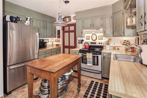 frugal kitchens and cabinets country kitchen mismatched cabinets yellow kitchens with
