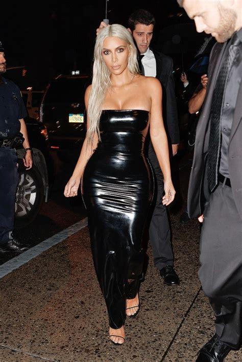 kim kardashian rocks long platinum hair  black latex