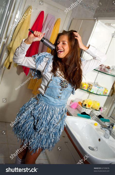 girl singing in bathroom teen girl singing in the bathroom stock photo 62109676