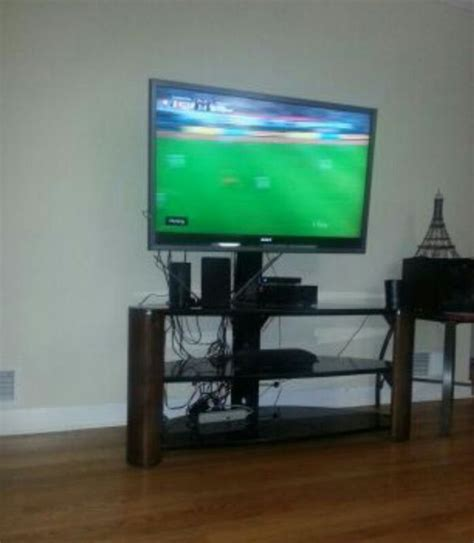 65 inch sofa table tv stand great condition has glass tables can hold a 65