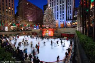 rockefeller center ice skating rink and christmas tree