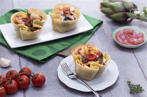 cucinare i carciofi giallo zafferano ricetta cestino di pasta fresca con carciofi gamberetti e