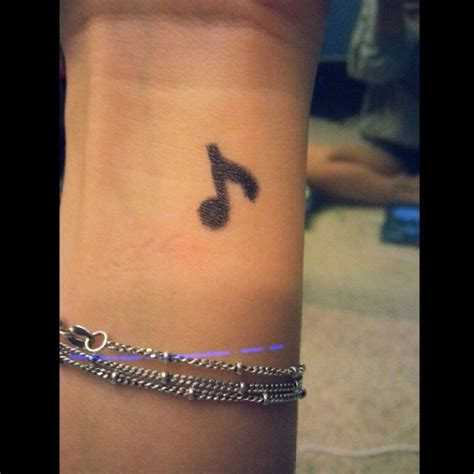 small musical note tattoos 41 awesome notes tattoos on wrists