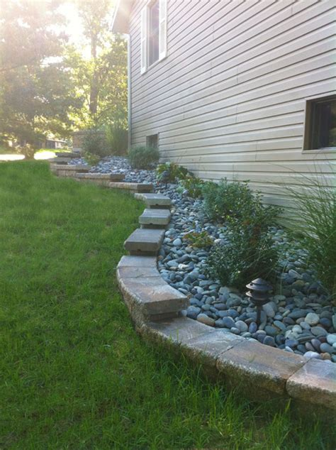 retaining wall side of house stepped retaining wall traditional landscape st louis by kf landscapes