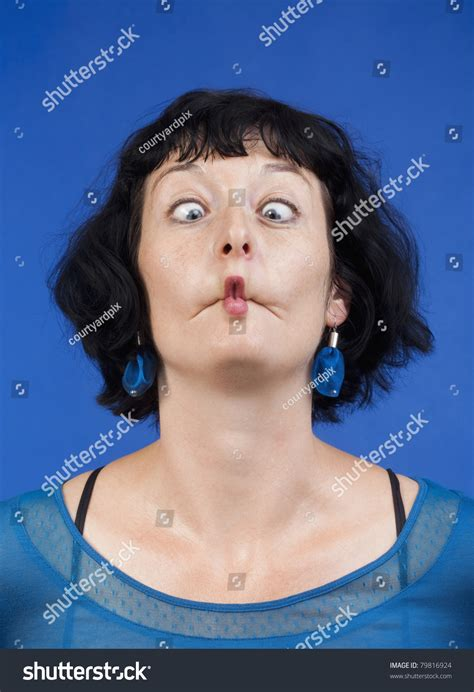 middleage woman fun middleaged woman making funny faces isolated stock photo